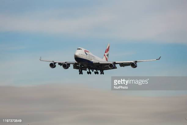 British Airways Boeing 747-400 with nickname Queen of the Skies commercial aircraft as seen on final approach with landing gear down landing at New...
