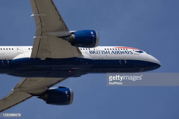 British Airways Boeing 787 Dreamliner aircraft as seen departing in the blue sky during rotation, take off, flying and retracting the landing gear...