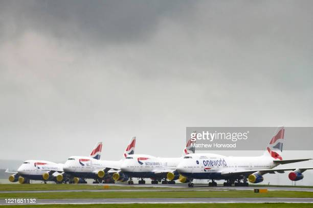 British Airways branded aircraft grounded at Cardiff Airport on April 28, 2020 in Cardiff, United Kingdom. British Airways has announced plans to...