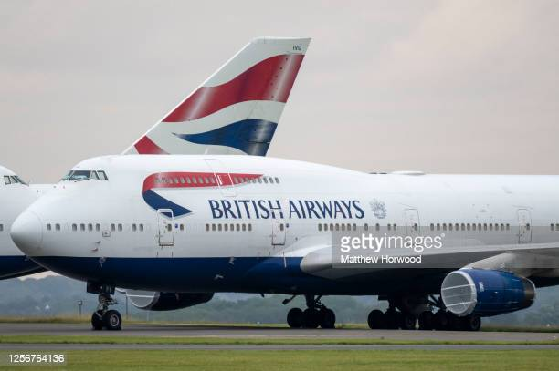 British Airways branded Boeing 747 planes sit grounded at Cardiff Airport during the coronavirus lockdown period on July 17, 2020 in Rhoose, Wales....
