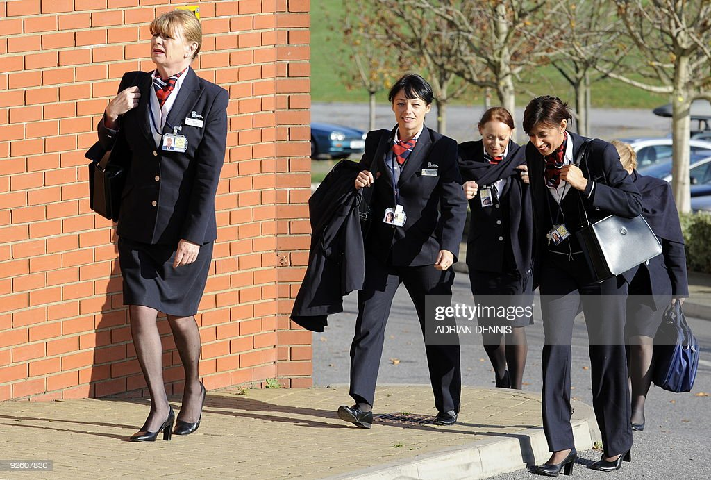 British Airways cabin crew arrive for the start of a union