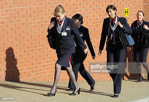 British Airways cabin crew arrive for the start of a union meeting to discuss a strike ballot at Sandown Racecourse in Esher Surrey southwest of...