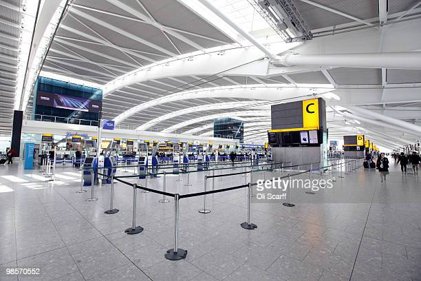British Airways checkin desks stand empty in the departures hall of Heathrow airport's Terminal 5 building on April 20 2010 in London England UK...