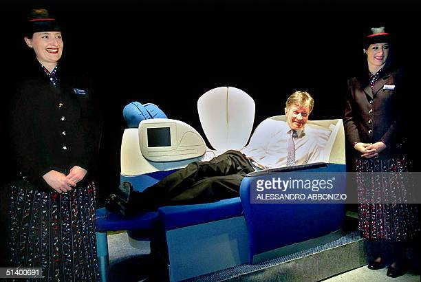 British Airways Chief Executive Bob Ayling launches the flying bed 25 May 1999 before the start of a press conference where BA announced its lowest...