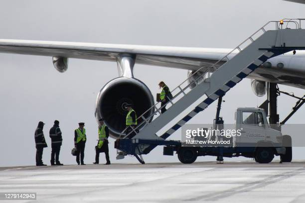 British Airways crew depart a Boeing 747-400 aircraft for the last time after it arrives at St. Athan airport on October 8, 2020 in St. Athan, Wales....