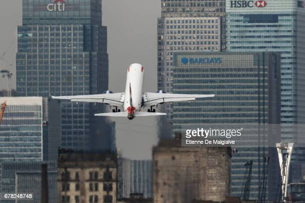 British Airways Embraer ERJ 190 takes off from the London City Airport LCY and climbs over Canary Wharf financial district on April 20 2017 in London...