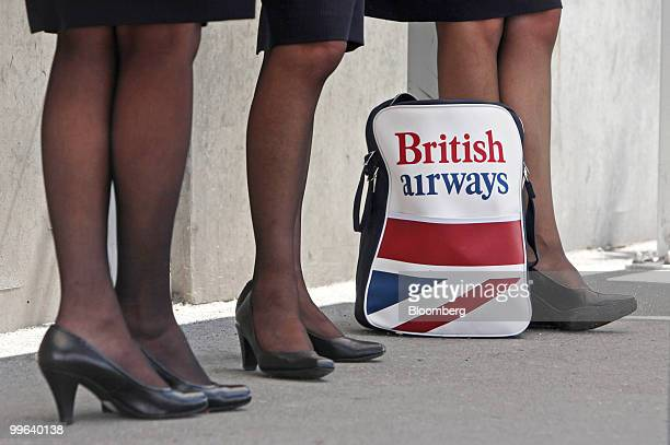 British Airways employees stand outside Terminal 5 at Heathrow airport in London UK on Monday May 17 2010 British Airways Plc and the Unite union...