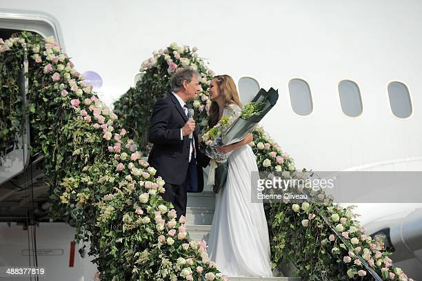 British Airways Executive Chairman Keith Williams presents flowers to British mezzosoprano Katherine Jenkins OBE folowing a live performance on the...