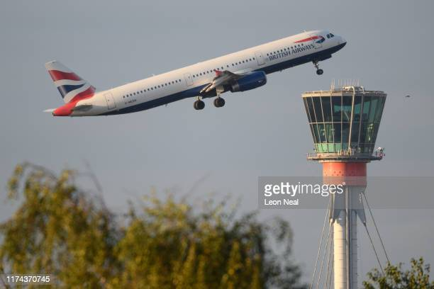 British Airways flight passes the control tower as it takes off from Heathrow Airport on September 13 2019 in London England Climate change...