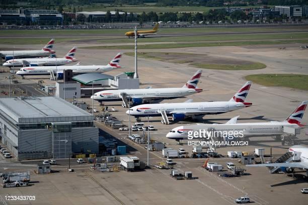 British Airways jets are seen at Heathrow Airport June 13 in west London.