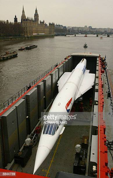 British Airways' last Concorde GBOAA sits on specially constructed barge as it passes the House of Commons in central London on it's journey down the...