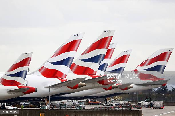 British Airways livery sits on tail fins of passenger aircrafts operated by British Airways a unit of International Consolidated Airlines Group SA...