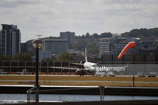A British Airways operated aircraft stands on the apron at London City Airport recently reopened after closing down due to the COVID19 pandemic in...