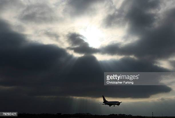 British Airways passenger aircraft landing at Manchester International Airport approaches the runway on 28 January Manchester, England. Baggage...