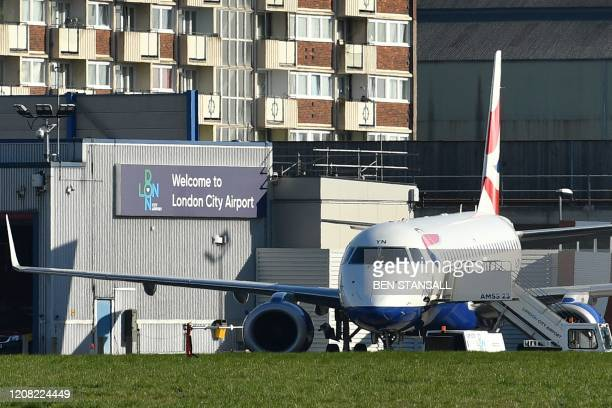 British Airways passenger jet sits on the tarmac at London City Airport in east London on March 25, 2020. - London City Airport, located close to the...