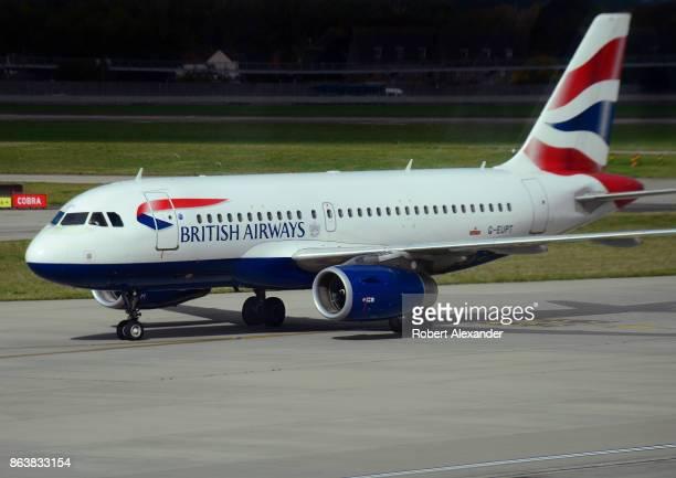 British Airways passenger jet taxis at Heathrow International Airport in London England