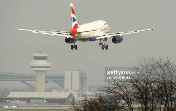 A British Airways passenger plane comes in to land at Gatwick Airport on March 19 2009 British competition authorities on Thursday ordered...