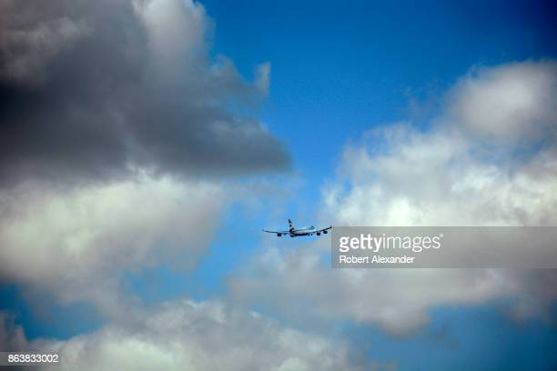 British Airways passenger plane flies into the clouds after lifting off from Heathrow International Airport in London England