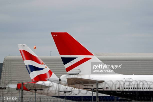 British Airways passenger planes are pictured at the apron at London Heathrow Airport in west London as the UK government's planned 14day quarantine...