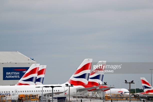 British Airways passenger planes are pictured at the apron at London Heathrow Airport in west London as the UK government's planned 14-day quarantine...