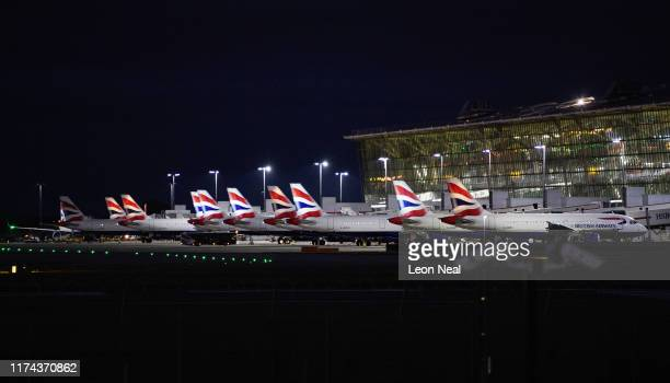 British Airways passenger planes are seen at Terminal 5 of Heathrow Airport on September 13, 2019 in London, England. Climate change protesters...