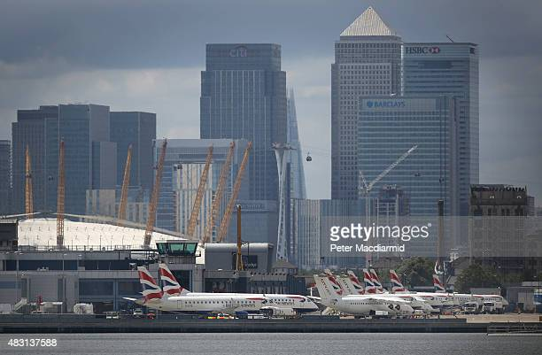 British Airways passenger planes line up at London City Airport in sight of Canary Wharf on August 6 2015 in London England US company Global...