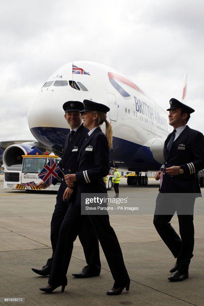 British Airways pilots walk in front of a British Airways