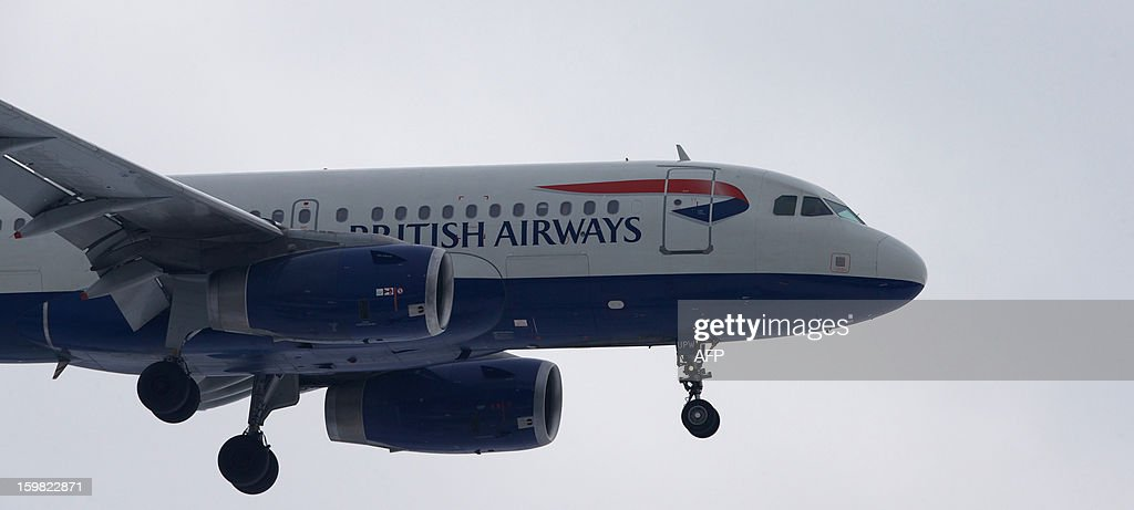 A British Airways plane flies in to land at Heathrow airport in west London on January 21, 2013 after the airport announced further flight cancellations due to adverse weather. London's Heathrow Airport warned of further flight cancellations on January 21 which would leave thousands more passengers stranded on the fourth day of delays after heavy snow swept across Britain.
