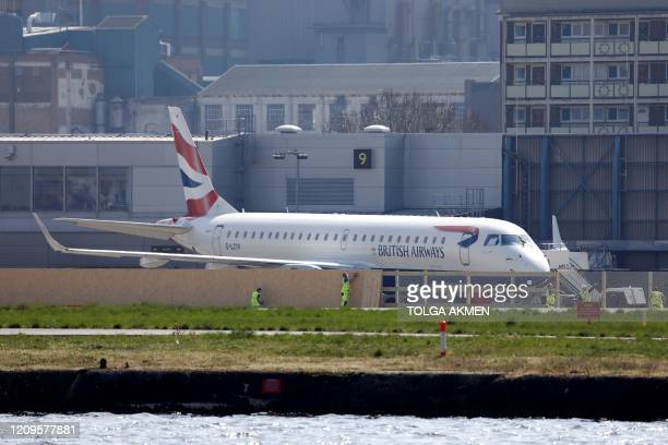 British Airways plane is parked at London City Airport in London on April 10, 2020 as warm weather tests the nationwide lockdown due to the novel...