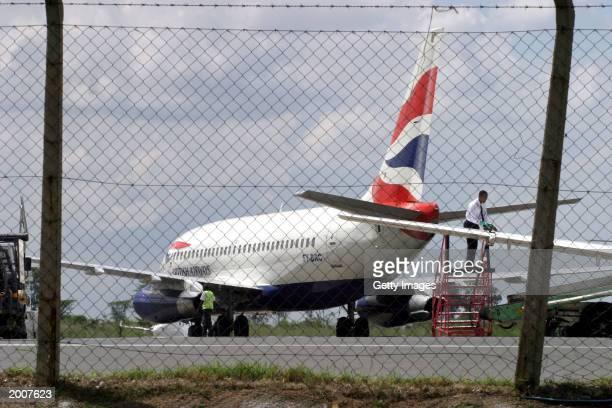 British Airways plane is parked on the tarmac of the Jomo Kenyatta International Airport May 17 2003 in Nairobi Kenya Officials at British Airways...
