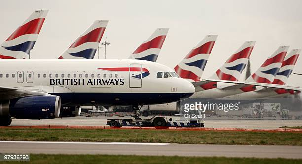 British Airways plane is towed through Heathrow airport as BA cabin crew stage the final day of their three day strike on March 22 2010 in London...