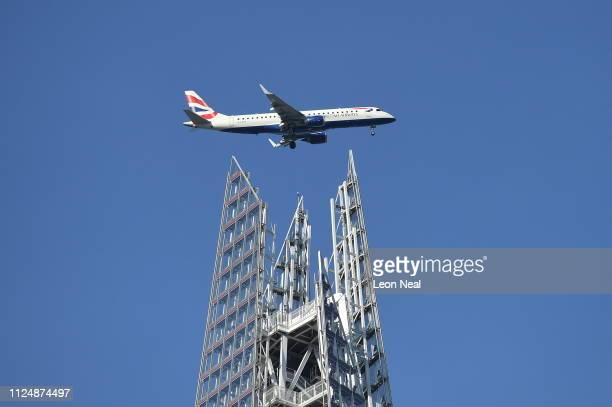 British Airways plane makes it way towards City Airport passing over the Shard building on February 14 2019 in London England