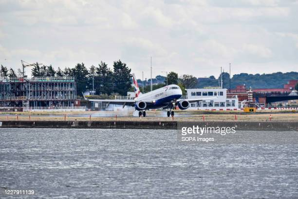 British Airways plane seen landing at London City Airport. British Airways confirms end of all business class LCY-JFK services from London to New...