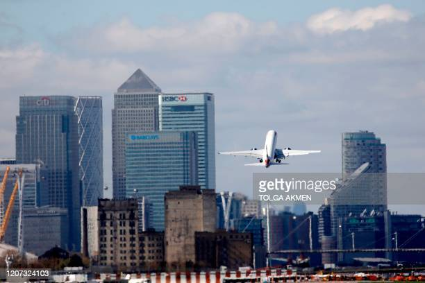 British Airways plane takes off from London City Airport, in east London, on March 16, 2020. - IAG, the owner of British Airways and Spanish carrier...