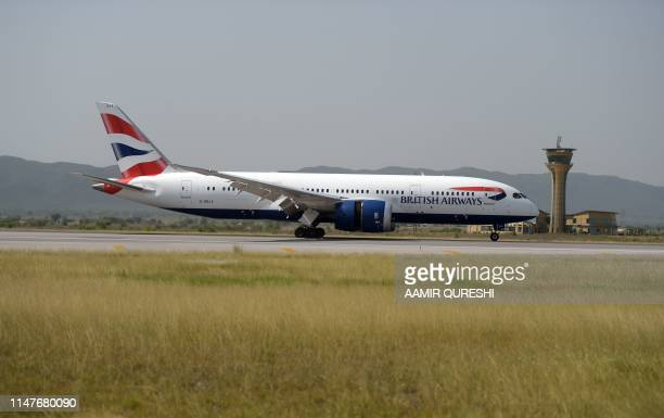A British Airways plane taxies on a runway upon their arrival at the Islamabad International Airport on the outskirts of Islamabad on June 3 2019...
