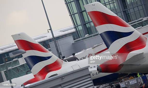 British airways planes are docked at Terminal 5 Heathrow airport in west London on January 21 2013 after the airport announced further flight...
