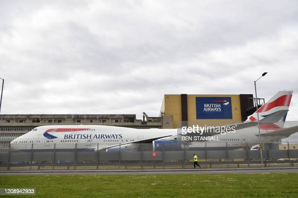 British Airways planes are parked at Heathrow airport in London on April 2, 2020. - Flagship airline British Airways will temporarily lay off 28,000...