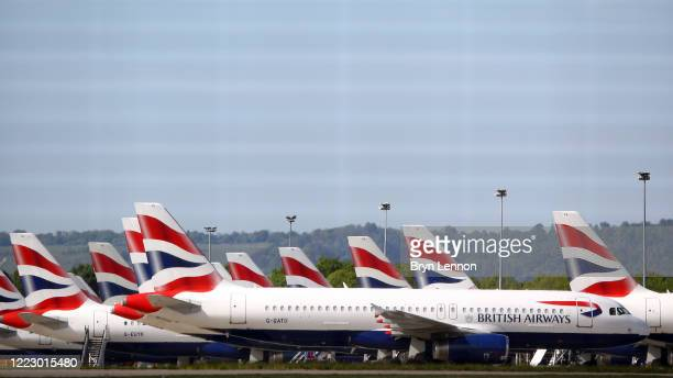British Airways planes are seen parked up after being grounded due to the coronavirus outbreak on May 05, 2020 in Gatwick, United Kingdom. The...