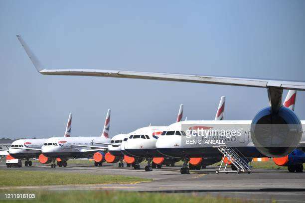 British Airways planes sit on the apron at Bournemouth airport in southern England on May 6 2020 British Airways is set to slash up to 12000 jobs as...