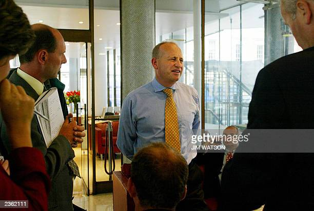 British Airways spokesman Steve Double speaks to reporters 29 July 2003 in the atrium of Congress House in London where British Airways executives...