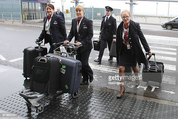 British Airways staff arrive at Terminal 5 at Heathrow airport in London UK on Friday March 19 2010 British Airways Plc Chief Executive Officer...