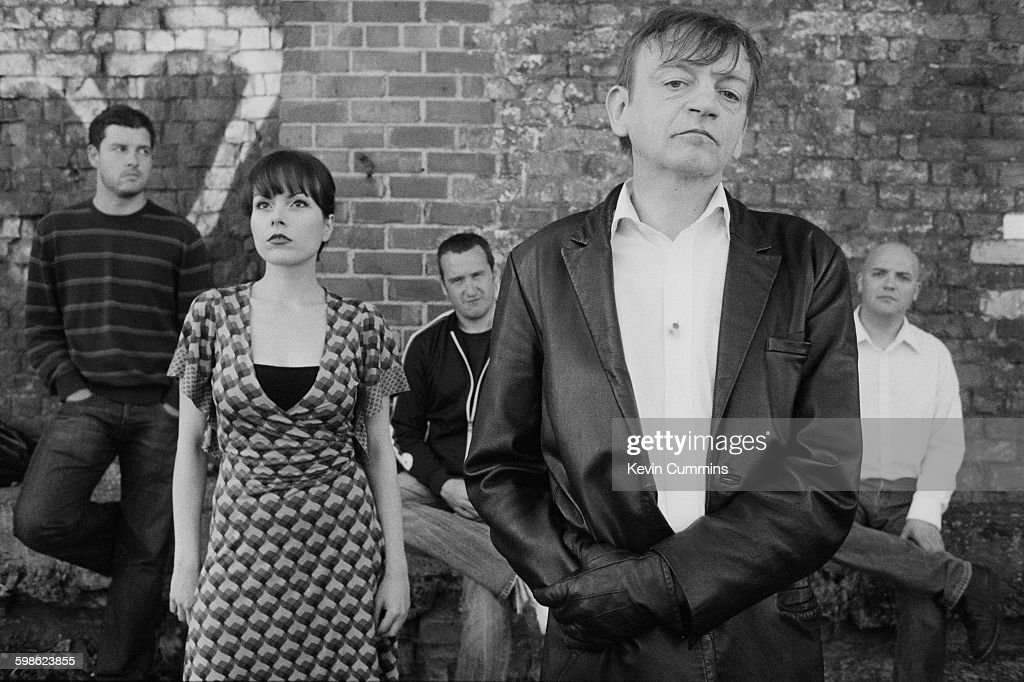 British alternative rock group The Fall, 15th August 2006. Left to right; guitarist Ben Pritchard, keyboard player Elena Poulou, bassist Steve Trafford, singer-songwriter Mark E. Smith and drummer Spencer Birtwistle.