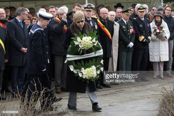 British Ambassador to Belgium Alison Rose lays down a flowers wreath during a tribute ceremony for the 30th anniversary of the Herald of Free...