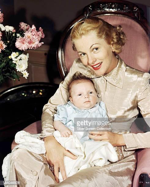 British American actress Joan Fontaine with her baby daughter Deborah Leslie Dozier 1948