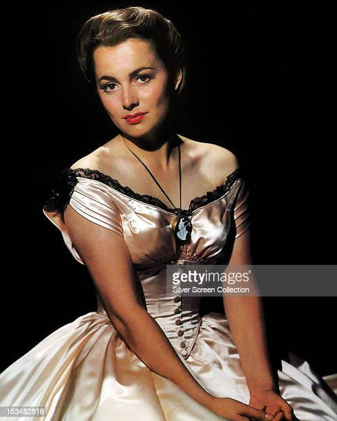 British American actress Olivia de Havilland wearing an offtheshoulder satin ball gown in a publicity still for the western 'Santa Fe Trail' directed...