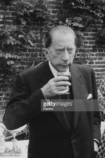 British American petrolindustrialist Jean Paul Getty enjoying a drink at a pool party organised in occasion of the opening of his new oil company UK...