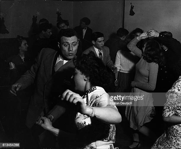 British and American soldiers mingle as they dance the jitterbug with their dates at a club in Warrington
