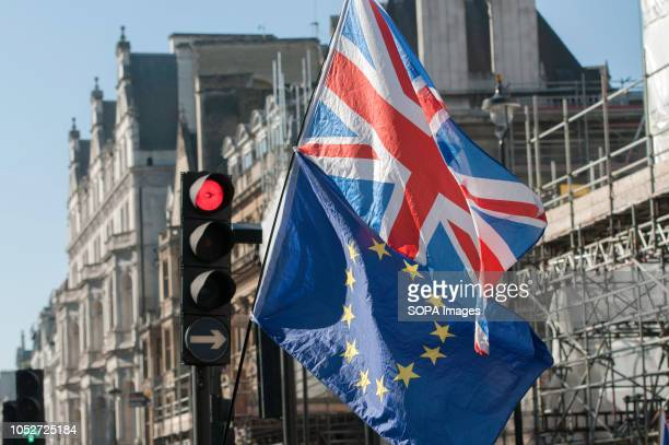 British and European Union flags are seen raised during a huge demonstration organised by the People's vote campaign The rally gathered at Park Lane...