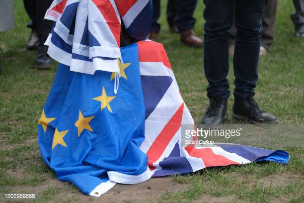 British and European Union flags lie intermeshed at a small demonstration of pro-Remain activists near the European Parliament the day after...