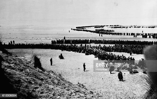 British and French troops await a hurried evacuation from the beaches at Dunkirk France in June 1940 German forces were rapidly advancing towards the...